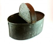 One side of the vintage bait holder has a hinged lid with airholes.