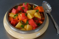 A colourful summer fruit salad complements the colours of this salad bowl.