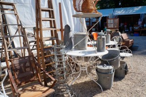Vintage french garden  items for sale at a Parisian market.