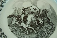 The centre of the plate showing the intricate detail of the fighting soldiers.