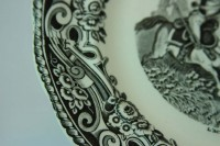 The fine detail on the black scalloped rim of the vintage plate.