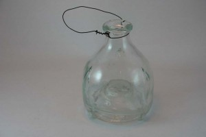 A vintage french glass wasp trap.
