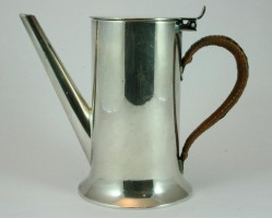 An elegant small silver water pot.